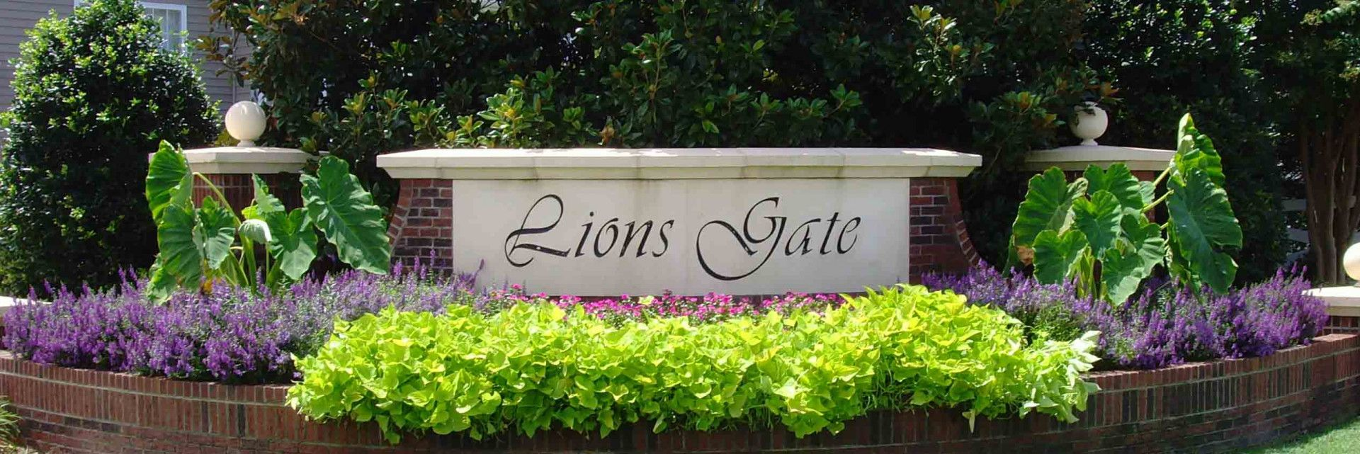 Front Entrance of Lions Gate with flowers